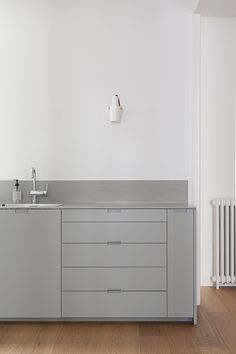 Barcelona apartment by INTSIGHT - beautiful minimal grey kitchen  #Kitchens #Interiors