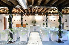 Vintage green organza chair sashes , ailse runner, swagged pillars for the ceremony.