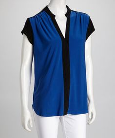 Take a look at this Black & Blue Cap-Sleeve Top by Wrapper on #zulily today!
