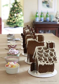 How to host a gingerbread house decorating party on YummyMummyKitchen.com   One of our favorite parties of the year.
