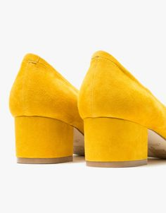 From Jeffrey Campbell, a classic small heel in Mustard. Features round toe, suede uppers, leather lining, rolled cuff, small heel, matching suede covered heel, capped heel and synthetic outsole.  • Suede heel in Mustard • Round toe • Suede uppers • L