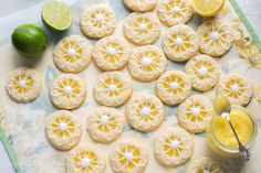Lemon-Lime Shortbread Thumbprint Cookies filled with homemade Lemon Curd and topped with a simple Lime Icing - a wonderfu