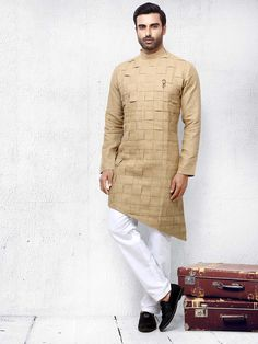 Shop Festive function beige colored solid kurta suit online from India. Indian Men Fashion, Mens Fashion Wear, Gents Fashion, Traditional Indian Mens Clothing, Mens Traditional Wear, Gents Kurta Design, Boys Kurta Design, Wedding Dresses Men Indian, Wedding Dress Men