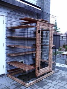Catio - Outdoor cat enclosures appears to be made from pet crate panels attached to planks.