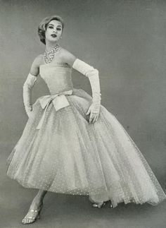 Christian Dior, April 1956. We love the fifties! See our vintage patterns online http://webstore.quiltropolis.net/stores_app/Browse_dept_items.asp?Shopper_id=3203430824403203Store_id=198Page_id=17categ_id=384parent_ids=0name=%3Cimg+src=http://webstore.quiltropolis.net/stores_app/images/images_198/icon.gif+align=absmiddle+border=0%3E+Vintage+Patterns