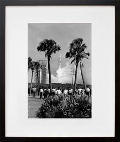 """October 11, 1968 was a warm day at Cape Kennedy Air Force Station in Florida, but a cool breeze rustled through palm fronds, comforting trousered onlookers—captured in black and white in S68-48662 as the Apollo 7 lifted off. As the astronauts experienced their first liquid hydrogen-fueled ride, commander Walter M. Schirra Jr. reported, """"She is riding like a dream."""" The crew orbited the Earth for 11 days, sending back the first live television broadcast from an American spacecraft."""