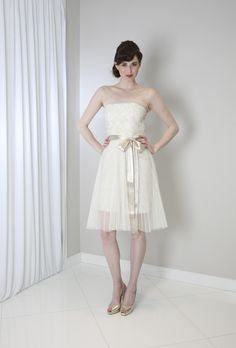 """""""Sugar"""" strapless wedding dress with ivory bow sash by Randi Rahm Spring 2016. Article: 18 Chic Short Wedding Dresses for Laid-Back Brides. Photography: Courtesy of Randi Rahm. Read More: http://www.insideweddings.com/news/fashion/18-chic-short-wedding-dresses-for-laid-back-brides/2012/"""