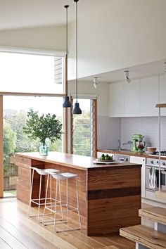 Wood island // kitchen // large windows // bright