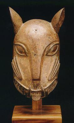 "Benin Ornamental Mask of a Leopard Head - PF.5013  Origin: South-Central Nigeria  Circa: 1700 AD to 1897 AD  Dimensions: 7.25"" (18.4cm) high  Collection: African  Medium: Brass"