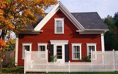 red house white trim black shutters
