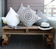 Make a pallet bench cosy with plenty of cushions | @Meghan174's balcony overlooking the beach
