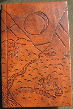 Hand bound hard leather journal hand carved