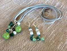 Handmade pendant necklace & earrings with ceramic pearls and Green cristal