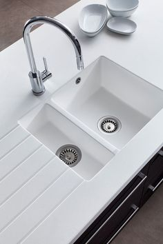 Stunning encore glacier white worktop with undercounted white sink. Think this really works matching the two together.