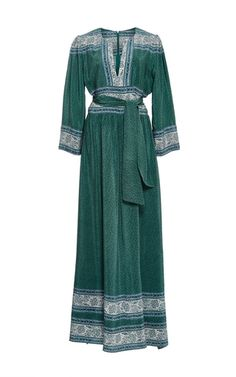 This long sleeve **Sea** dress is rendered in silk and features an a-line silhouette with a v-neckline, a sash at the waist, and a floor length hem.