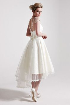 19 Sweet Short Wedding Dresses You'll Love - short wedding dresses are great for casual weddings, destination weddings, and elopements. You might also use the short white dress for other wedding related events including the engagement party, bridal shower, rehearsal dinner, and after party.