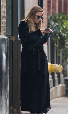 Mary-Kate Olsen Steps Out In A Black Belted Maxi Coat