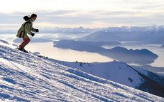 Woman skis on Villarrica Volcano in Pucon, Chile