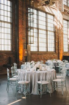 Adapt a brewery reception space with a classic silver, grey and white color palette. Wedding Chairs, Wedding Reception Decorations, Wedding Table, Industrial Wedding, Rustic Wedding, Wedding Designs, Wedding Styles, Diy Wedding Planner, Brewery Wedding
