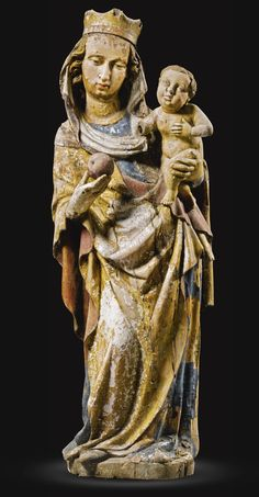 SOUTH GERMAN, ULM, MID-15TH CENTURY VIRGIN AND CHILD WITH AN APPLE gilt and polychromed limewood 101cm., 39¾in.