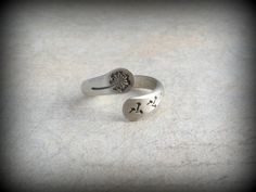 Hand stamped sterling silver dandelion ring that is hand forged and made to order in your size. Because this is all handmade no 2 are ever