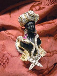 Big Venetian blackamoor brooche Bust Warrior with   Yellow Gold 18 kt - Silver 800 Diamonds rose cut kt 2,05 Diamonds riund cut kt 1,01 Big Turban Rubis kt 0,95 Bust in carved ebony Size cm 9 (+/-) Hand made