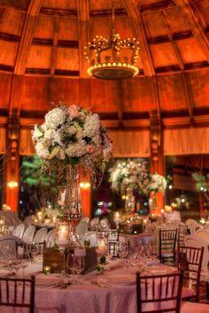 Statement floral centerpieces and a crown chandelier #reception #regal