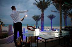 Champagne sabering on the Turquoiz beach. Be IMPRESSED. Be TURQUOIZ.