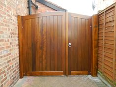 Generally double gates transmit strong messages such as demanding respect or a feeling of solemnity. Wooden Side Gates, Wood Fence Gates, Wooden Garden Gate, Garden Doors, Gates Driveway, Fences, Door Gate Design, House Gate Design, Wooden Gate Designs