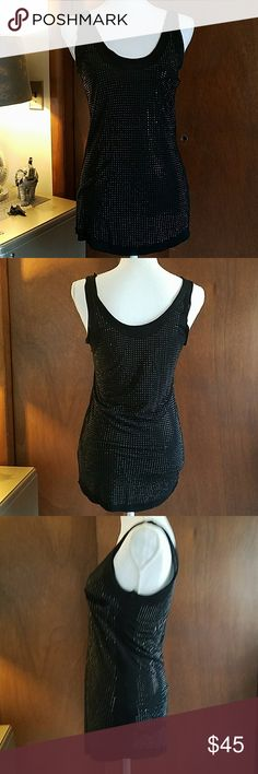 Guess rhinestone tank ***A MUST HAVE*** This tank is one of my favorite items from my closet.  Not one rhinestone is missing its made so nice.  Rhinestones all through out the back and front.  Little pocket on the front.  Goes perfect with the guess black pants in my closet with the skull on the pocket.  Bundle and save!! Guess Tops Tank Tops