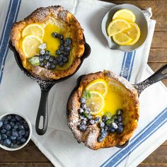 Mini Dutch Baby Pancakes cooked in individual cast iron skillets. They puff up and turn a beautiful golden brown before we spoon in homemade lemon curd and sprinkle with fresh blueberries.