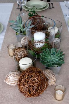 I like the mix of textures on these banquet tables.  You could do a simplified version of this.  Burlap or lace runner, succulent favors, mason jars with flowers, and candles....