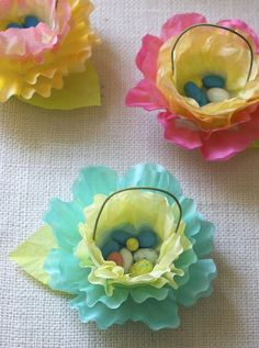 Coffee Filter Flower Baskets -- cute for an Easter treat display, Birthday party or Wedding Favors. (Maybe wrap the treats in plastic wrap first, to keep fresh and prevent spills.)