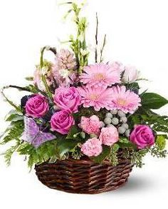 This basket floral arrangement is a popular choice lovely in the pink, lavender and white colour scheme seen here. It includes roses, gerbera daisies, butterflies and much more. Basket Flower Arrangements, Floral Arrangements, Cemetery Flowers, Easter Flowers, Church Flowers, Flower Pots, Flower Baskets, Floral Bouquets, Flower Crafts