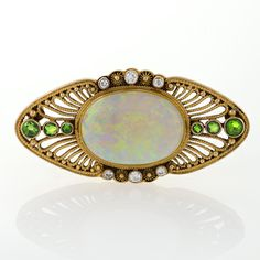 Louis Comfort Tiffany for Tiffany & Co Diamond, Demantoid Garnet, Opal and Gold Filigree Brooch.   Available exclusively at Macklowe Gallery.
