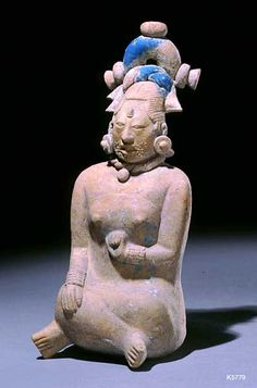 Justin Kerr image: Image:  5779  File date:  2001-01-27  Caption:  Jaina Woman  Description:  Maya. Jaina. clay with traces of paint. height 20.3 cm Regal woman with bare breasts and elaborate hairdo. .