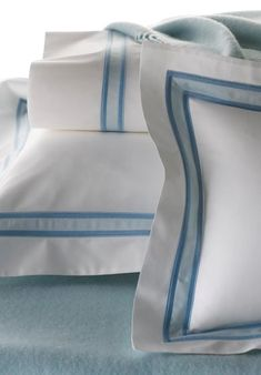 Topaz: At once tailored and elegant, bold yet restrained, Topaz incorporates appliqué and embroidery to create the strong and dynamic effect of this contemporary design.