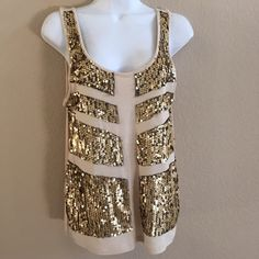 HP Rock & Republic gold sequin tank Rock & Republic tank gold sequin with black mesh backing. size small. 100% rayon. Bare used. Excellent condition. Rock & Republic Tops Tank Tops