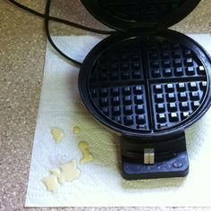 Put a paper towel under your waffle maker before you start pouring the batter. Easy cleanup. :)