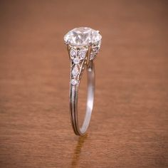 This but a larger diamond. A rare Edwardian Engagement Ring, circa The old European cut diamond is J color and clarity. Fine filigree and milgrain Antique Wedding Rings, Antique Engagement Rings, Deco Engagement Ring, Diamond Engagement Rings, Beautiful Wedding Rings, Dream Wedding, Ring Verlobung, Wedding Jewelry, Ideias Fashion
