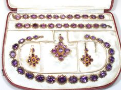 Amethyst and gold parure, comprising of a necklace, a pendant, a pair of bracelets and a pair of earrings.