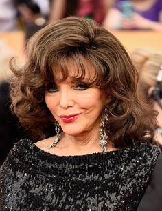 Joan Collins Medium Curls with Bangs - Joan Collins attended the SAG Awards rocking her signature big hair.