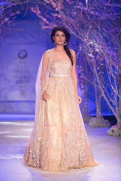 Jeweled white ivory Indian wedding dress by Jyotsna Tiwari. More here: http://www.indianweddingsite.com/bmw-india-bridal-fashion-week-ibfw-2014-jyotsna-tiwari/