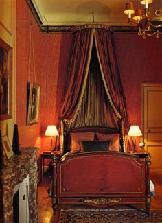 Decorator Timothy Corrigan's restored Chateau du Grand-Lucé. One of 16 guest rooms - Chambre de Empire.