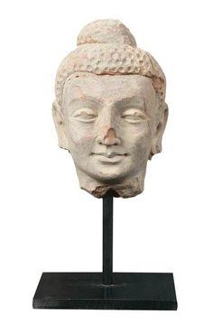 Head of Buddha, Gandhara, 2nd - 3rd Century. Terracotta. Height: 6 in.