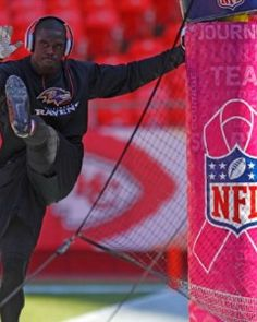 Making a profit off a deadly disease when no legitimate strides are being made. A player warms up next to a Kansas City Chiefs field goal post outfitted with special pink padding in honor of Breast Cancer Awareness month.