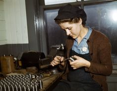 War production workers at the Vilter [Manufacturing] Company making M5 and M7 guns for the U.S. Army, Milwaukee, Wis. Ex-housewife, age 24, filing small parts. Her husband and brother are in the armed service. February 1943. Photographed by Howard R. Hollem for the Farm Security Administration.