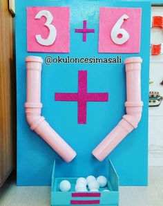 This is such an innovative way to teach math! The children can count out the balls and then at the end count the total. you can change and play with the numbers too! Kids Learning Activities, Toddler Learning, Classroom Activities, Fun Learning, Preschool Activities, Hands On Learning, Teaching Aids, Teaching Math, Preschool Learning