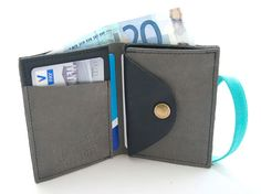 A smartly designed wallet has places to stash all of his stuff.