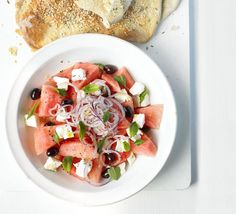 A cool, refreshing combo for warm summer evenings       ½ a watermelon (about 1½ kg), peeled, deseeded and cut into chunks     200g block feta cheese, cubed     large handful black olives     handful flat-leaf parsley and mint leaves, roughly chopped     1 red onion, finely sliced into rings     olive oil and balsamic vinegar, to serve  For the crispbread      ½ a 500g pack white bread mix     1 tbsp olive oil, plus a little extra for drizzling     plain flour, for dusting     1 egg white,